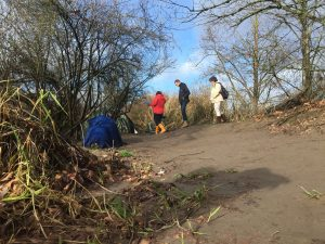 Staff from MDC and Greater Lakes Mental Health visit a camp along the Puyallup River during the Jan. 29, 2016 Point-In-Time Count.