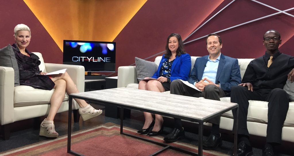 TV Tacoma CityLine host Amanda Westbrooke (left) in the studio with MDC Development Director Maria DeVore, 2015 Share Breakfast Chair Tom Hume and MDC Scholar Jamyrick Fontenot from Lincoln High School.